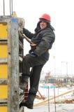 Arbeitskrafterbauer an der Baustelle Lizenzfreie Stockfotos