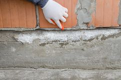 Arbeitskraftpunkte an Imprägnierungsmembran, Schutzschicht gegen Feuchtigkeit stockbilder