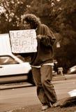 Arbeitsloser, der um Hilfe bittet Stockbilder