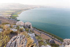Arbel mountain cliffs above Galilee Sea. Stock Photos