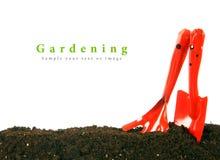 Arbeta i trädgården Det trädgårds- hjälpmedlet på jord Fotografering för Bildbyråer