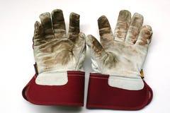 arbeta i trädgården handskar använt arbete arkivfoto