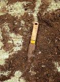 Arbeta i trädgården hjälpmedlet av forntiden Arkivfoto