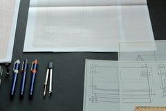 Arbeta på en teknisk teckning Fotografering för Bildbyråer