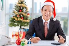Arbeta på juldag Arkivbild
