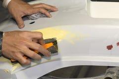 Arbeta sandpappra abc-bok, innan att måla Fotografering för Bildbyråer