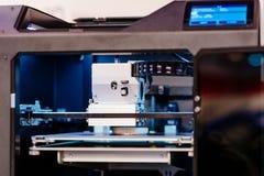 Arbetande skrivare 3D Fotografering för Bildbyråer