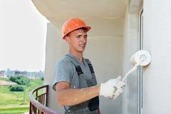 arbetare för byggmästarefacadeplasterer royaltyfri fotografi
