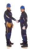 arbetare för konstruktionshandskakning två Fotografering för Bildbyråer