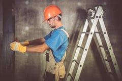 Arbetare för konstruktionsleverantör arkivbilder