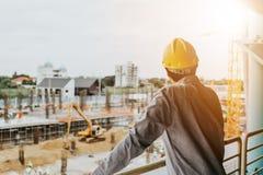 Arbetare i en konstruktionsplats Arkivbilder