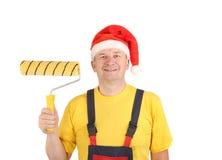 Arbetare i santas hatt med rulle. Royaltyfria Foton