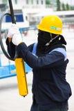 Arbetare med fjärrkontrollen Fotografering för Bildbyråer