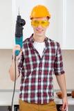 Arbetare med hålapparaten Arkivfoton