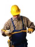 Arbetare med måttstock arkivbild