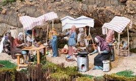 Arbetare på julcrechen Royaltyfri Bild