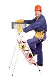 Arbetare på stege med toolboxen royaltyfri foto