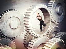 Arbetare på kugghjulet Fotografering för Bildbyråer