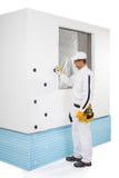 Arbetare som fixar en låspinne Royaltyfria Foton