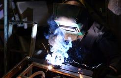 Arbetare-welder svetsningsmetall Arkivbild