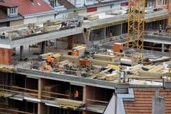 Arbetarna på konstruktionsplatsen Arkivbilder