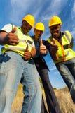 Arbetartummar upp arkivbilder