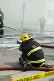 arbete för 6 brandmän Arkivbild