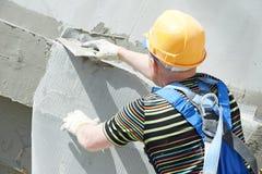 arbete för byggmästarefacadeplasterer Royaltyfria Foton