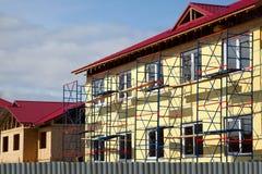 arbete för konstruktionsfullföljandehus Arkivfoto