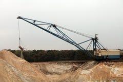Arbeten för tungt maskineri i industriellt villebråd arkivfoto