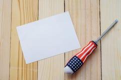 Arbets- dag - skruvmejsel med flaggan av USA modellen Royaltyfri Foto