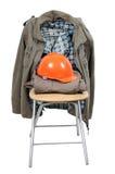 Arbetshjälm och kläder Arkivbilder