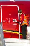Arbetsledaretillåtelse till kabinbesättningen att öppna dörren arkivbild