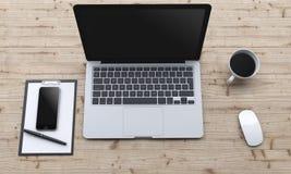 Arbetsplats med bärbara datorn, smartphone, kaffe, notepad Arkivfoto