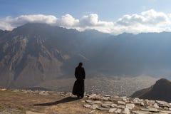 Arbetsplats: munk-ensling Se den fåfänga världen Arkivbild