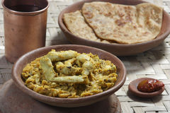 Arbi Ka Saag - A dish made from Colocasia. Arbi Ka Saag is prepared from Arbi (colocassia root) cooked with fresh Indian spices. Served with Roti and (Indian Stock Photography