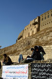 Arbil Castle. Kurdish young people sitting in front of Arbil Castle Royalty Free Stock Photography