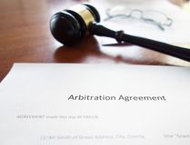 Arbitration agreement gavel. An arbitration agreement contract with court gavel Royalty Free Stock Photography