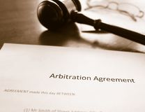 Arbitration agreement and gavel. An arbitration agreement and court gavel Stock Images