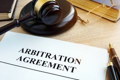 Arbitration agreement resolution of commercial disputes. Arbitration agreement resolution of commercial disputes on a desk Stock Photography
