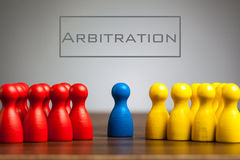 Arbitration concept with pawn figurines on table. Grey background Royalty Free Stock Image