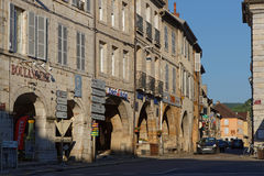 ARBOIS, France, May 26, 2017 : Arbois main street. The town cent. Res on an arcaded central square where one can sample the local wines Royalty Free Stock Images