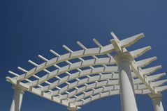 Arbor. A white arbor isolated against a blue sky Royalty Free Stock Photography