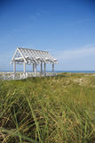 Arbor on Beach. Arbor near beach with grasses in foreground.  Vertical shot Royalty Free Stock Photography