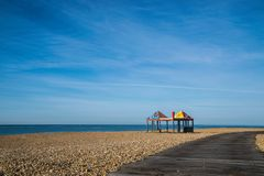 Arbor on the Beach. Arbor on the Folkestone pebble beach at summer morning Royalty Free Stock Image