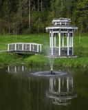 Arbor with a bridge on a pond. With a fountain Royalty Free Stock Photos