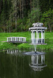 Arbor with a bridge on a pond. With a fountain Royalty Free Stock Images