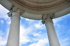 Arbor with columns. In the background of a cloudy sky Royalty Free Stock Images
