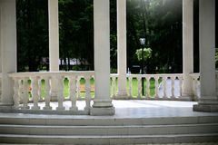 An arbor with columns in the park. Columns background Royalty Free Stock Photos