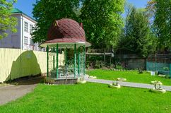 Arbor in courtyard of house on Putna Street, Vitebsk, Belarus. Arbor in courtyard of house on Putna Street on sunny May day, Vitebsk, Belarus royalty free stock image